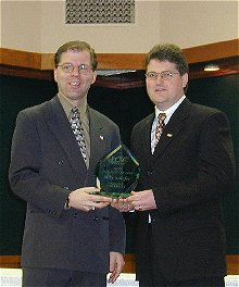 Mike Schafer receives the COTY Award from ECAC Associate Commissioner Steve Hagwell