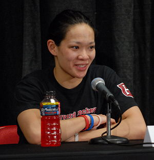 """Julie Chu speaks in her final press conference after her quadruple overtime loss against the Wisconsin. The size of her smile after such a defeat is unprecedented.<br />John E. Van Barriger / <a href='http://words-photos.com'>words-photos.com</a>"""" /></p> <div class="""