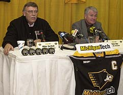 Mike Sertich (left) and Michigan Tech athletic director Rick Yeo at a press conference to announce Sertich's permanent hiring as head coach of the Huskies.