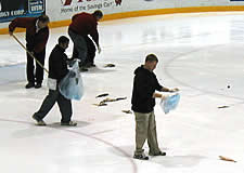 Lynah Rink workers have the messy job of cleaning up. (photos by Mark Anbinder)
