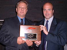 USCHO.com's Dave Hendrickson and Scott Weighart accept the Scarlet Quill Award at the recent Boston University Hall of Fame Banquet.