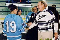 Bradford Boss, who founded the men's club team at URI and donated $1.3 million to the building that will bear his name, meets the URI hockey teams.