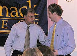 Joe Exter accepts one of his multiple awards at the Merrimack hockey banquet last week.