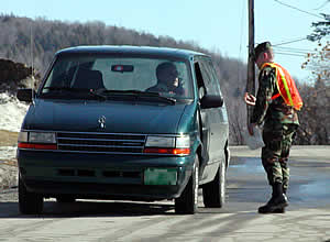 Norwich Cadet James Urso checks incoming vehicles prior to Friday's semifinal game. (Photo by Ed Trefzger)