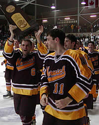 Chris Fuss holds the trophy while the Boudreau brothers, Ed (front) and Mike look on. (Photo: Ed Trefzger)