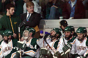 George Roll behind the Oswego bench during Saturday's D-III championship. (Photo: Ed Trefzger)