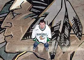 North Dakota goalie Marc Ranfranz embraces his Sioux heritage, and says the team's logo honors Native Americans.