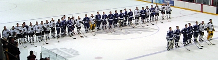 Both teams show their respect for one another after the game.