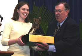 Chanda Gunn accepts the Humanitarian Award from founding trustee John Greenhalgh (photo: Pedro Cancel).