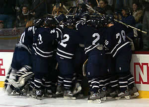 Middlebury mobs Levi Doria after he scores the game winner. (Photo by Russell Jaslow)