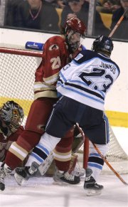 DU captain and defenseman Ryan Caldwell fends off Jon Jankus in front of the net (photo: Pedro Cancel).