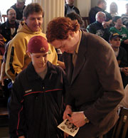 Lessard signs autographs after the presentation (photo: Kelly McGinnis).
