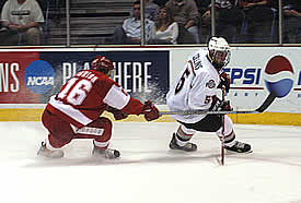 Wisconsin's Adam Burish (l.) chases Ohio State's Sean Collins during the NCAA tournament in 2004, Mike Eaves' first national tourney appearance as Badger coach (photo: Timothy Muir McDonald).