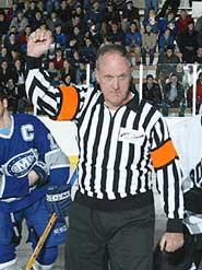 Bill Stewart lines up for a ceremonial drop of the puck.