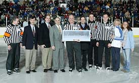 Bill Stewart stands with ECAC officials, family and fellow referees during a pre-game ceremony before his last game. (photos: Brian Beard)