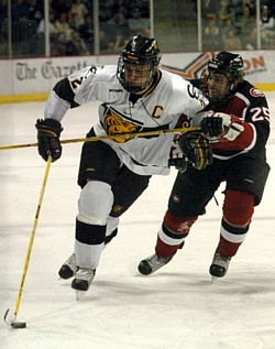 CC captain Mark Stuart (here trailed by SCSU defenseman Matt Stephenson) helped bring the Tigers back from the brink (photo: Casey Gibson).