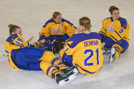 Laura Hurd (2nd from left) and three Elmira seniors make sure they are the last to leave the ice following their final career game. (Photo: Angelo Lisuzzo)