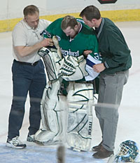 Goaltender Mike Ella is helped off the ice here, but returned to keep the Lakers in the hunt.