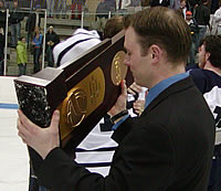 Panther assistant Chris LaPerle admires the D-III trophy.
