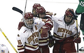 Ulanski (l.) celebrates with Paul Stastny (r.) and teammates during the Pioneers' title-winning matchup against UND in April 2005.