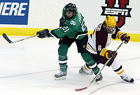 Erik Fabian (l., with Judd Stevens) scored two goals to give UND an unexpected lift in the national semifinals (photo: Pedro Cancel).