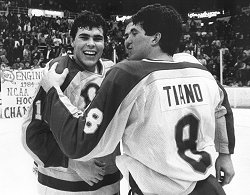 Adam Oates and John Tiano celebrate the Engineers' national championship.