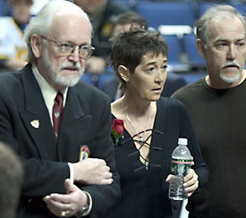 Patty Sertich, 52, was diagnosed with a brain tumor last year. She was escorted to the Hobey ceremony by a Committee official (left) and husband Steve. (photo: Melissa Wade)