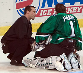 UND's Jordan Parise gets a look from the trainer here, but the netminder hasn't shown much weakness late in the season.