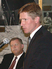 North Dakota athletic director Roger Thomas looks on as new coach Dave Hakstol speaks at a news conference Friday. (photo: Patrick C. Miller)