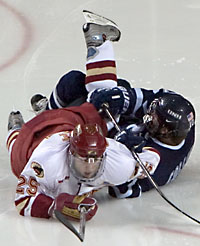 Sean Collins (r.) and Matt Carle both go down here, but after Sunday's results, Hockey East's season is done while the WCHA plays on (photo: Melissa Wade).