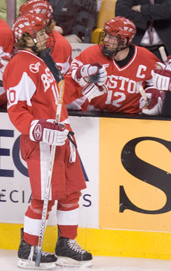 BU's Chris Higgins (l.) is congratulated by captain Brad Zancanaro after his goal against Harvard (photo: Melissa Wade).
