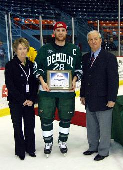BSU captain Jean-Guy Gervais, here with from CHA commissioner Bob Peters and assistant commissioner for operations Deb Slough, was tournament MVP (photos: Matt Mackinder).