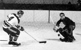 The Crimson's Bill Cleary goes in on net in the Beanpot back in the '50s (photo: Harvard athletic communications).