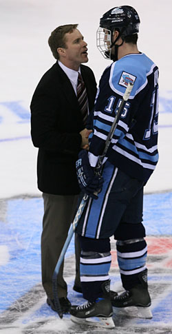 Wisconsin's Mike Eaves warmly greets Maine's Greg Moore. Eaves coached the Black Bear on both the U.S. National Development Under-18 team and on the World Juniors squad. (photo: Melissa Wade)