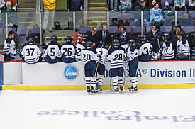 Middlebury uses a TV timeout to discuss strategy ... or perhaps to share a joke. (photo: Angelo Lisuzzo)