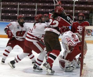 Goalie Jessie Vetter remains amidst the chaos surrounding her. (Photo: Ryan Coleman)