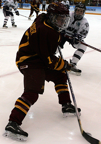 Junior forward Becky Wacker handles the puck in the Gophers' win over UNH Friday (Photo: Ryan Coleman)