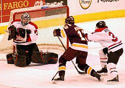 Bobby Goepfert (l.) makes a stop during St. Cloud State's play-in victory over Minnesota-Duluth (photo: Tim Brule).
