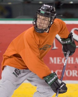 Bina skates in practice with the Sioux on Dec. 10, 2005 (photo: Melissa Wade).