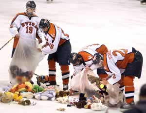 """Utica players collect teddy bears donated to Operation Sunshine. (photo: Michael Doherty/Utica <i>Observer-Dispatch)</i>"""" /></p> <div class="""