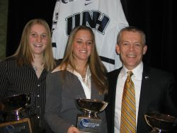 UNH's Sadie Wright-Ward, Sam Faber, and Brian McCloskey pose with their trophies.