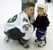 Adam Krug with his son at a 'Skate With The Warriors' event (photo: Matt Mackinder).
