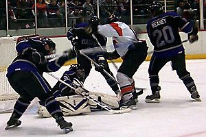 Niagara clears the puck from in front of the net.