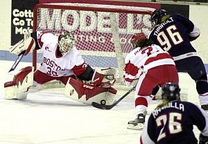 Boston University netminder Allyse Wilcox (shown here stoning Connecticut's Dominique Thibault) has drawn plaudits for her performance (photos: Boston University media services).