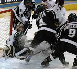Jeff Lerg making one of his 13 saves in the first period of the championship game. (photo: Skip Strandberg)