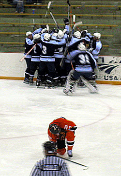 Fredonia celebrates its overtime victory. (photo by Tom Naeger.)