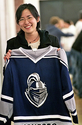 Hiroko Yuki with the jersey presented to her by the Geneseo Ice Knights. (photo: V.W. Hope)