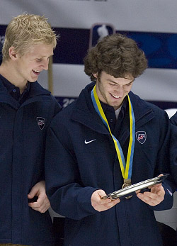 Brian Lee (l.) and Taylor Chorney enjoy Team USA's bronze medal from the WJC.