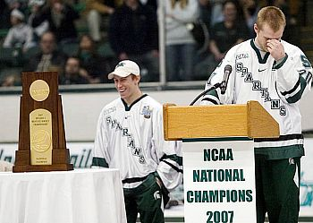 Two faces of joy: Jeff Lerg (l.) is all smiles as captain Chris Lawrence chokes up at the Munn Arena rally.