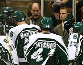 Michigan State head coach Rick Comley addresses the Spartans (photo: Melissa Wade).